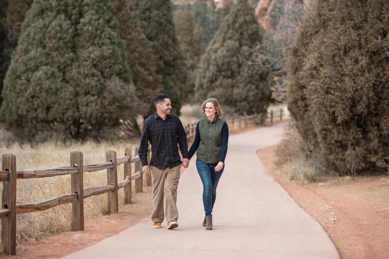 couple walking holding hands on a path