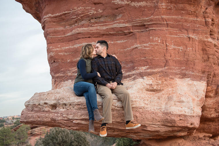 couple kissing on a rock at Garden of the Gods